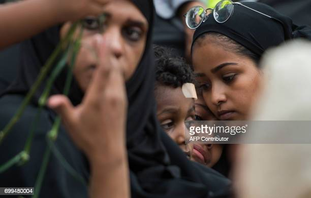 TOPSHOT Family members cry during a vigil in Reston Virginia on June 21 for Nabra Hassanen The 17yearold Muslim girl was killed with a baseball bat...