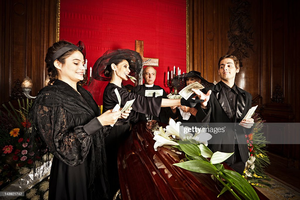 Family members dealing money legacy on funeral : Stock Photo