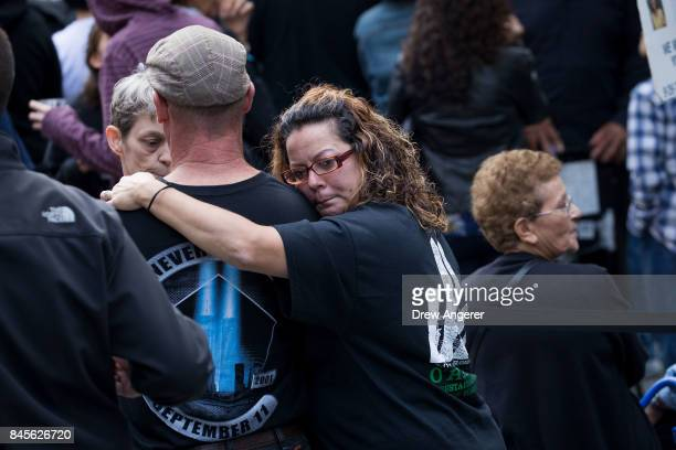 Family members first responders and others attend a commemoration ceremony for the victims of the September 11 terrorist attacks at the National...