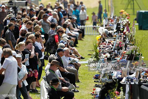 Family members gather at a national memorial service for the 29 miners that lost their lives in the Pike River Mine at Omoto Racecourse on December 2...