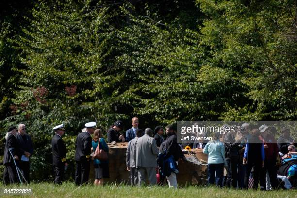Family members gather at the crash site of the plane at the Flight 93 National Memorial on the 16th Anniversary ceremony of the September 11th...