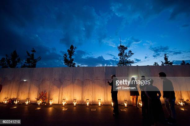 Family members gather during a luminaria service at the Flight 93 National Memorial on September 10 2016 in Shanksville Pennsylvania Tomorrow marks...