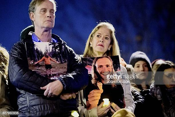 Family members hold photos of their son during a vigil honoring those who died in a warehouse fire in Oakland California on December 5 2016 The death...