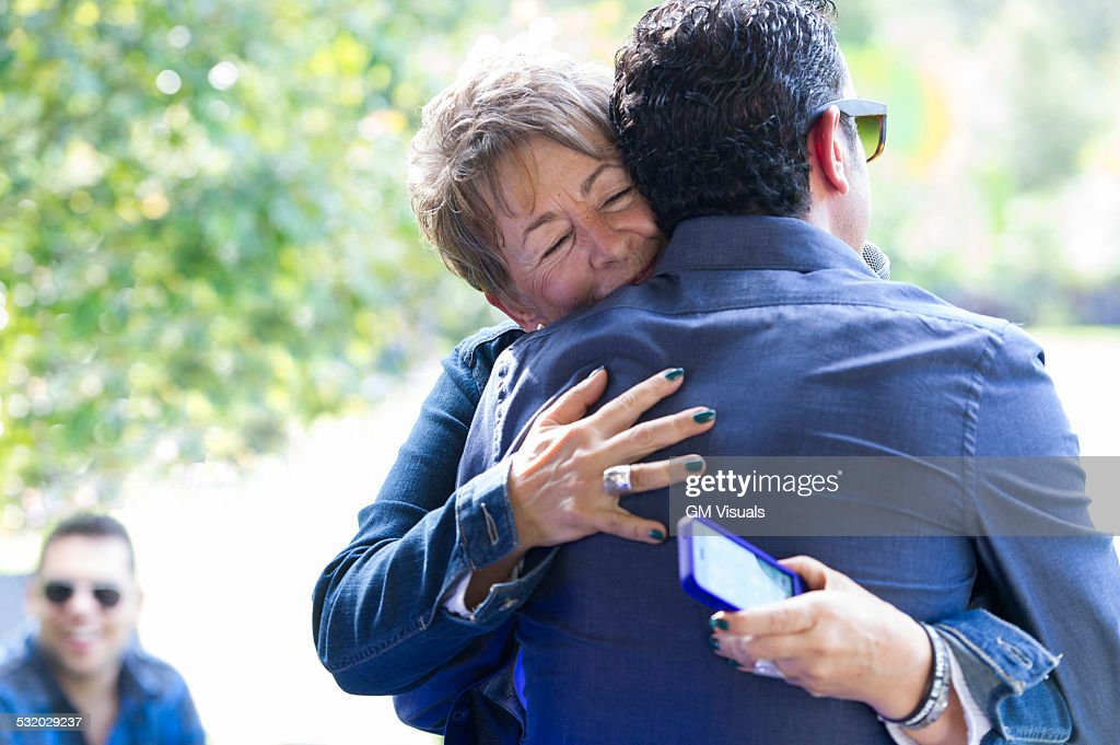 Family members hugging at reunion