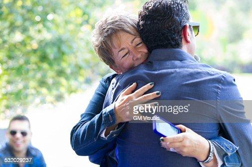 Family members hugging at reunion