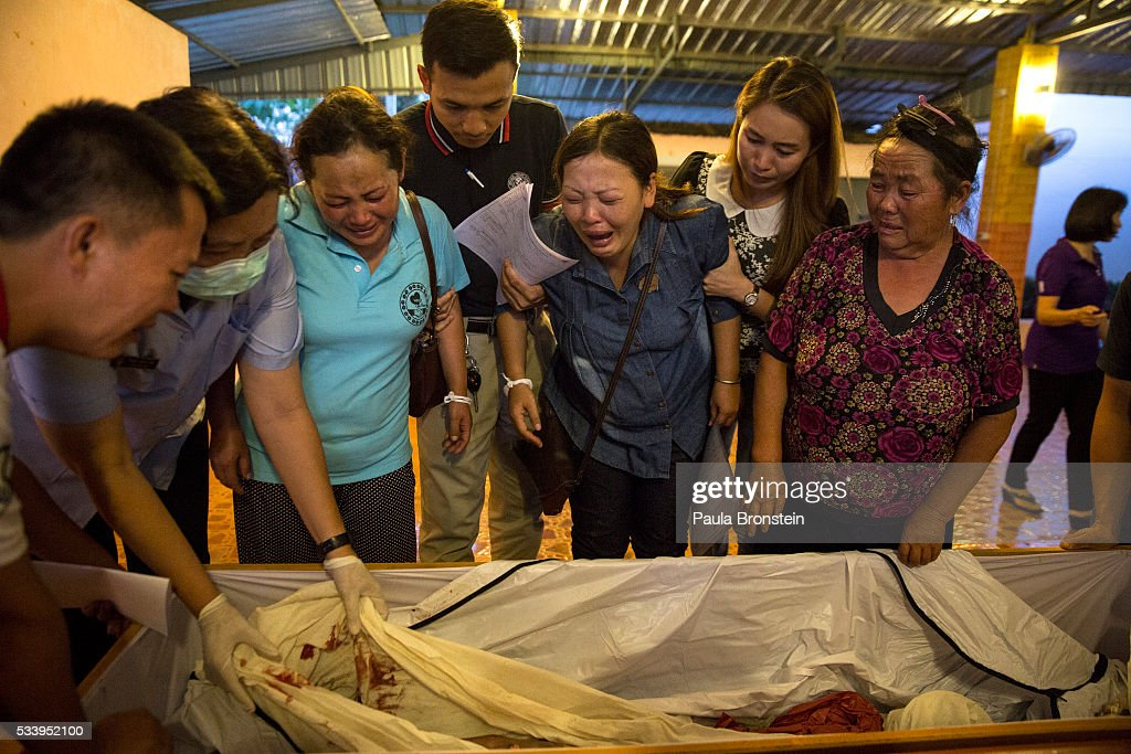 Family members identify the burnt body of Kanjanaporn (May) Lasasong age 8, after DNA tests were completed in Wiang Papao, Chiang Rai province May 24, 2016. A tragic fire broke out on Sunday night killing at least 17 girls at the Pitakkiat Wittaya school, home to pupils from impoverished local hill tribes in the region, they were aged between 5 to 13. Based on reports, many of the 38 students were asleep when the fire swept through the elementary school in Chiang Rai Province and investigations are still being carried out to find the cause of the fire.