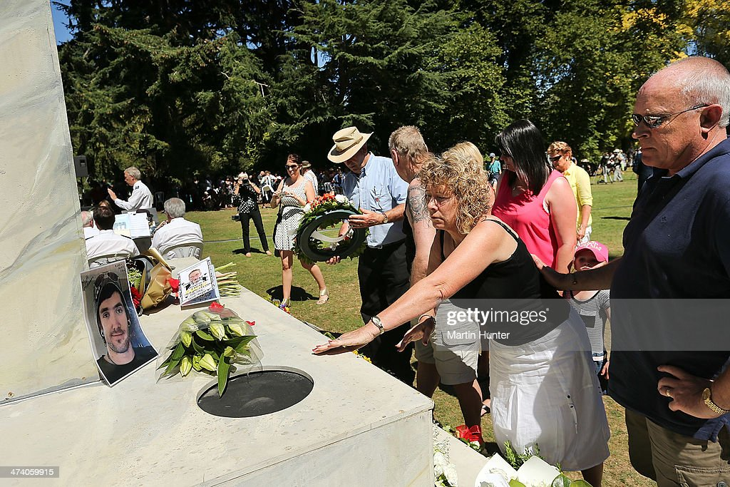 Family members lay a wreath during a Civic Memorial Service held in the Botanical Gardens for victims of the 2011 Christchurch Earthquakes on February 22, 2014 in Christchurch, New Zealand. The earthquake measuring 6.3 in magnistude devastated Christchurch killing 185 people and causing an estimated $40 billion in damage to the city's buildings and infrastructure.