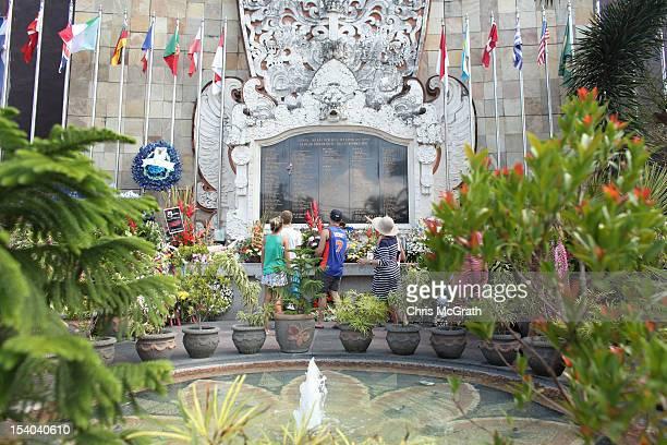 Family members lay flowers after the visit of Australian Prime Minister Julia Gillard at the Bali Bombing Memorial at Jalan Legian Bali on October 13...