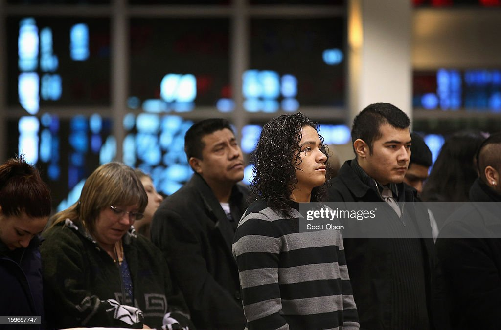 Family members listen to a prayer during a funeral mass for Rey Dorantes, 14, at St. Mark Church on January 18, 2013 in Chicago, Illinois. Dorantes died after being shot six times while he was sitting on the front porch of his home while talking on the phone on January 11. Dorantes's murder was the 21st homicide recorded in Chicago for 2013, a city which saw more than 500 homicides in 2012.