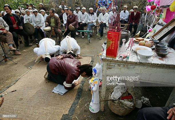Family members mourn for the dead during the funeral of a senior citizen in Jiaodai Township on October 27 2005 in Lantian County of Shaanxi Province...