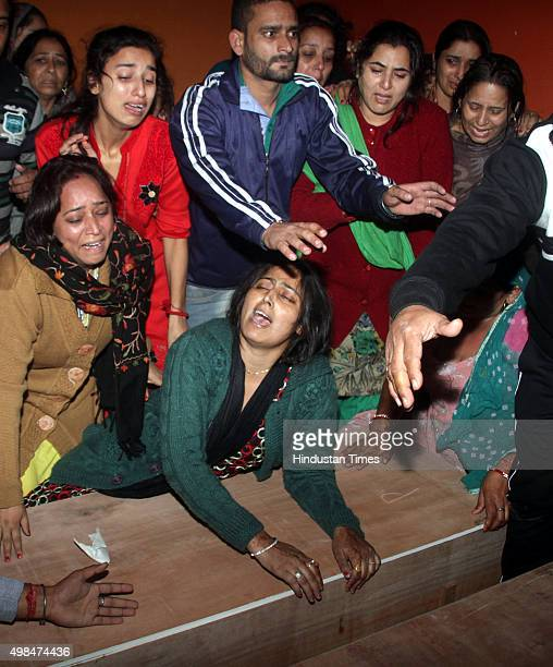 Family members mourn near the coffin of newly married couple Arjun Singh Chib and Vandana Chib who were killed in the helicopter crash at Katra on...