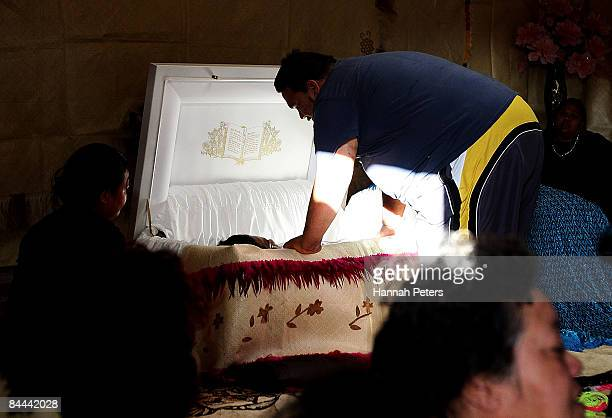 Family members mourn over the body of slain bystander Halatau Naitoko after he is returned to his family at his home on January 25 2009 in Auckland...