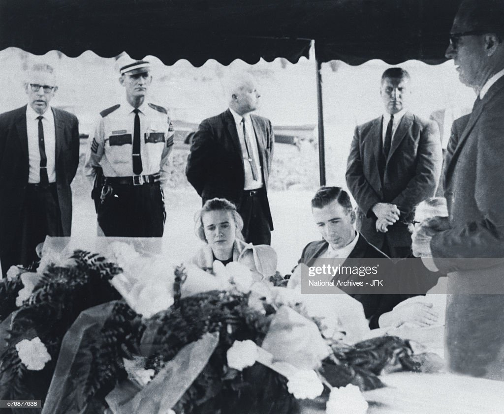 Family members mourn the death of Lee Harvey Oswald at his funeral at Rose Hill Memorial Park in Fort Worth Texas Seated from left are Marina...