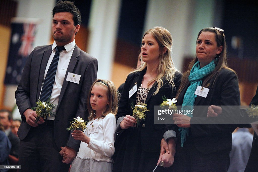Family members of a victim of the Bali bombing wait to place flowers on a wreath during the National Memorial Service in the Great Hall at Parliament House to mark the 10th anniversary of the terrorist attacks, on October 12, 2012 in Canberra, Australia. The ceremony marks tenth anniversary of the 2002 Bali suicide bombs that killed 202 people including 88 Australians.