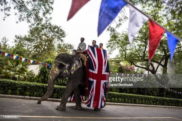 Family members of British expatriates living in New Delhi take rides on Rupa a rented elephant during an event as British expatriates gather to...