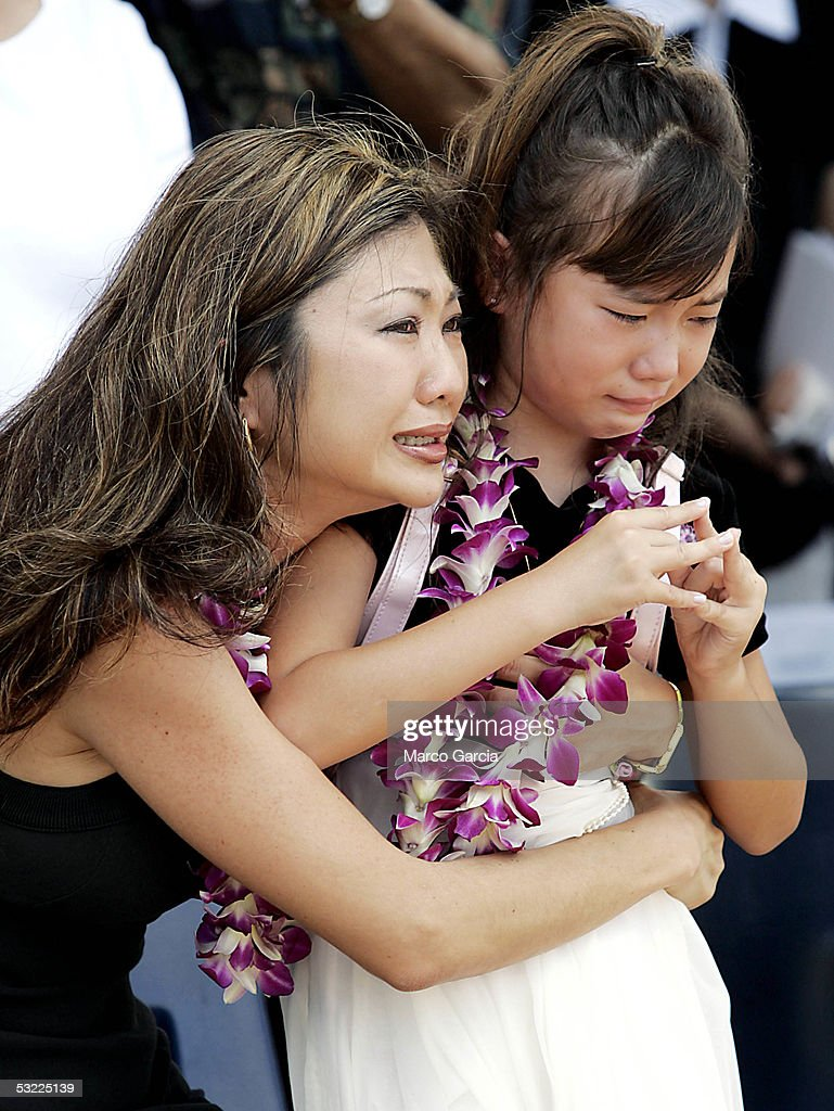 Family members of Daniel Richard Healy, a Navy SEAL killed in action while conducting combat operations in Afghanistan, grieve during a memorial service held at the National Memorial Cemetery of the Pacific July 11, 2005 in Honolulu, Hawaii.