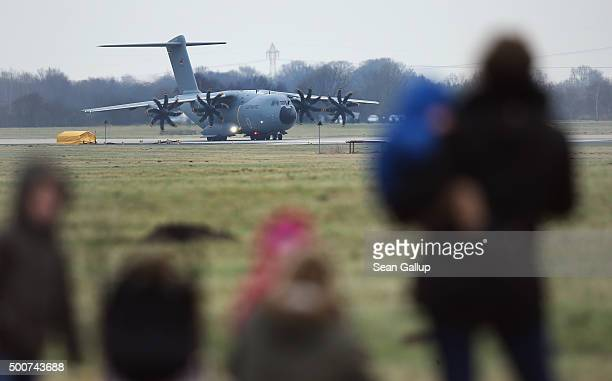 Family members of departing soldiers watch as a Luftwaffe A400M plane transporting 40 Bundeswehr members and their equipment prepares to depart for...