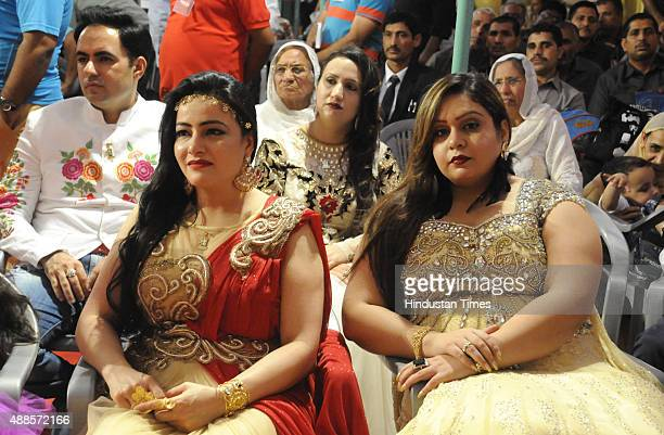 Family members of Head of Dera Sacha Sauda sect Gurmeet Ram Rahim Singh attend a press conference during the premiere of his upcoming movie MSG2 at...