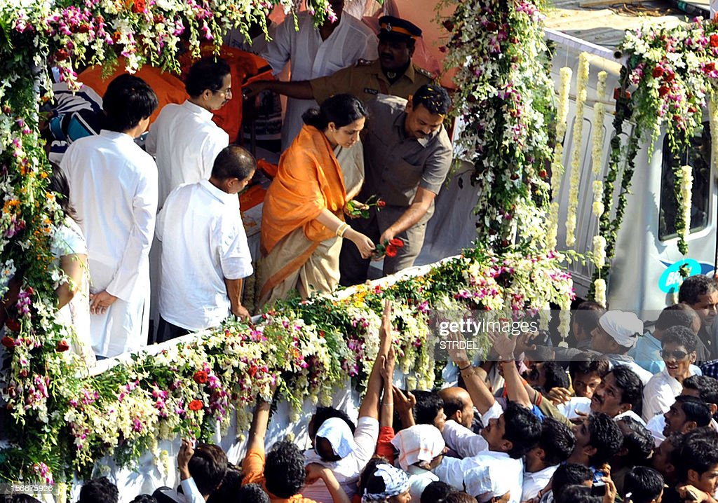 Family members of Indian Hindu nationalist Shiv Sena party leader Bal Thackeray gestures to supporters during his funeral in Mumbai on November 18, 2012. Huge crowds gathered in Mumbai to witness the funeral procession of Bal Thackeray, chief of the Hindu nationalist Shiv Sena party and one of India's most divisive politicians. Thackeray, who called his followers 'Hindu warriors' and was widely accused of stoking ethnic and religious violence, died aged 86, triggering a virtual shutdown of the city.