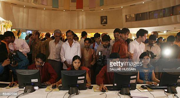 Family members of Indian stock traders as they watch trade during special trading on the occasion of Diwali the Festival of Lights inside the Bombay...