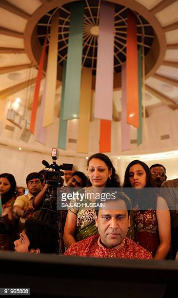 Family members of Indian stock traders watch as they trade during a special trading session on the occasion of Diwali the Festival of Lights inside...