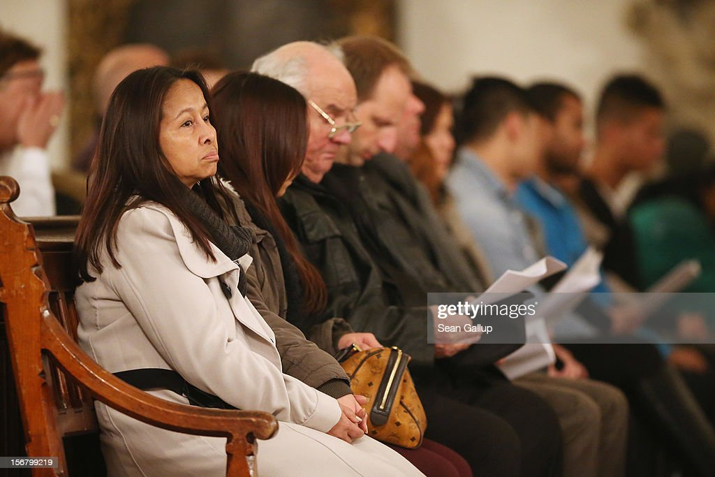Family members of Jonny K., including (from L to R) his mother, his younger sister Jenny and his father Lothar Gunter, attend a memorial service for Jonny and other victims of violence in Berlin at Marienkirche church on November 21, 2012 in Berlin, Germany. Jonny K. died after a group of youths beat him severely in the early hours of October 14 at Alexanderplatz. Investigations are continuing as three of the suspects remain abroad, one in Turkey and two in Greece.