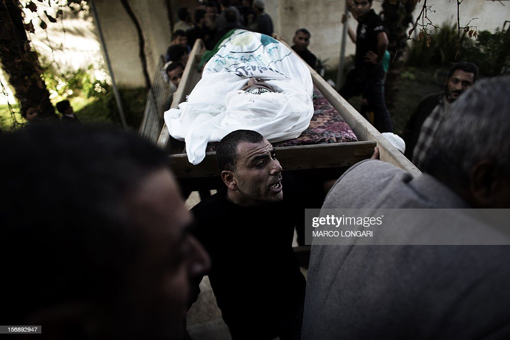 Family members of Judah Shamallah, one of the leaders of the Hamas' armed wing, the Ezzedine al-Qassam Brigades, carry his body during his funeral procession, in Gaza City, on November 24, 2012. Shamallah died overnight from injuries he endured from the week-long confrontation between Israel and Gaza militants that killed at least 160 people.