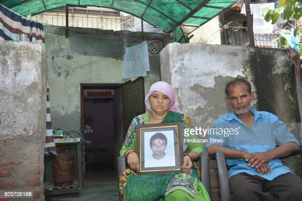 Family members of Mandeep Singh Negi mourn who was allegedly cremated by Sahibabad Police on July 13 on July 22 2017 in Ghaziabad India Mandeep Singh...