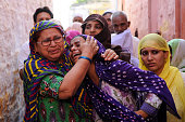 Family members of Mohammad Akhlaq mourn during his funeral at their village in Bisada on September 29 2015 in Greater Noida India Akhlaq was beaten...