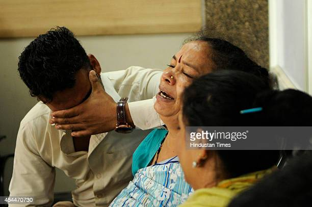 Family members of one of the four employees of Motherson Company who were killed in an accident mourn the death in the district hospital on September...