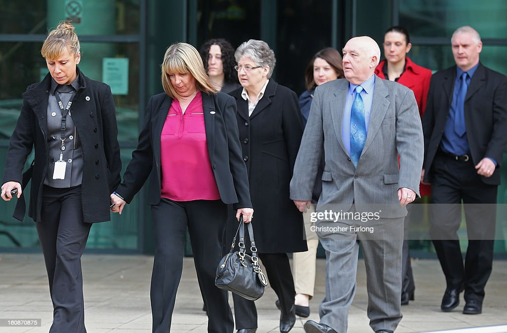 Family members of PC Nicola Hughes and PC Fiona Bone, led by a police liasion office (L), arrive at Preston Crown Court, where Dale Cregan is charged with their murder on February 7, 2013 in Preston, Lancashire. Dale Cregan, 29, stands accused of four murders, including PC Nicola Hughes and PC Fiona Bone on September 18, 2012 and also in two separate attacks earlier this year of Mark Short and his father David Short. Cregan is also being charged with an additional four counts of attempted murder.