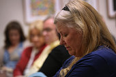Family members of people addicted to opioid pain pills and heroin listen during a support group on March 23 2016 in Groton CT The group Communities...