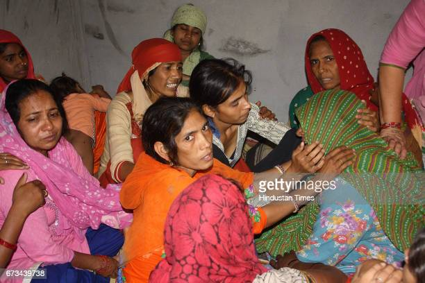 Family members of Sukma Martyr CRPF ASI Naresh Kumar mourning during the funeral at his native village Jainpur Tikola on April 26 2017 in Sonepat...