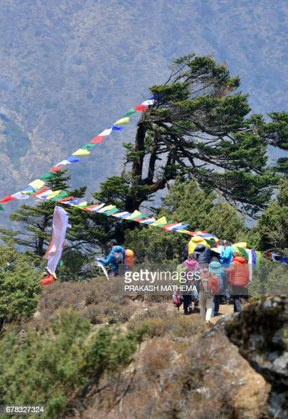 Family members of Swiss climber Ueli Steck gather at the site of his cremation at Tengboche some 300 kms northeast of Kathmandu on May 4 2017 The...