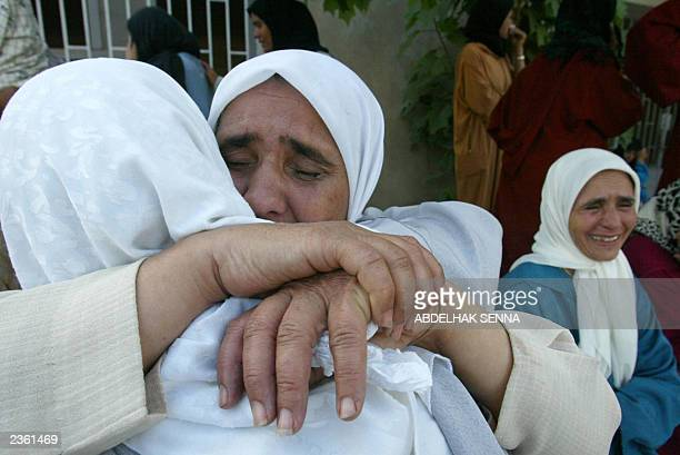 Family members of the accused cry as they are refused entry into the courthouse in Casablanca for the trial of 35 members of the banned Salafia...
