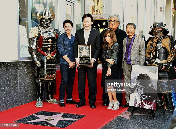 Family members of the late Japanese actor Toshiro Mifune pose for photos in Hollywood California on Nov 14 during a ceremony to celebrate the...