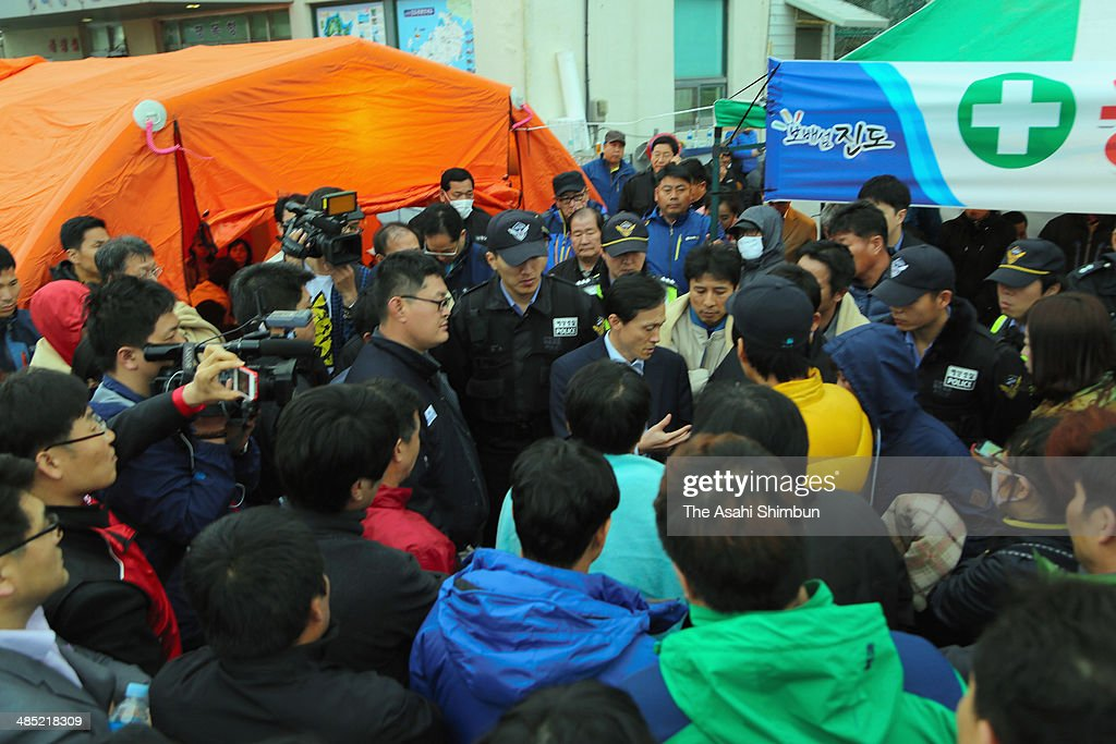 Family members of the missing passengers of a sunken ferry confront with staffs of coast guard as rescue operation struggled due to the bad weather and high tide at Jindo port on April 17, 2014 in Jindo-Gun, South Korea. At least six people are reported dead, with 290 still missing. The ferry identified as the Sewol was carrying about 470 passengers, including students and teachers, travelling to Jeju Island.