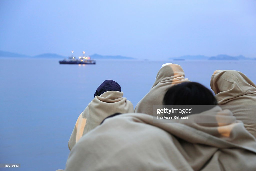 Family members of the missing passengers of a sunken ferry wait at Jindo port on April 17, 2014 in Jindo-Gun, South Korea. At least six people are reported dead, with 290 still missing. The ferry identified as the Sewol was carrying about 470 passengers, including students and teachers, travelling to Jeju Island.