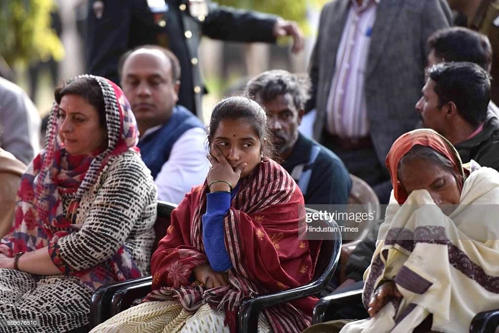 Family members of the rescued soldier Lance Naik Hanumanthappa during his funeral ceremony at Brar square crematorium on February 11, 2016 in New Delhi, India. Lance Naik Hanamanthappa Koppad of 19 Madras Regiment was rescued alive on night after being buried under 35 feet of snow for six days. The lone survivor of the February 3 Siachen avalanche that claimed the lives of nine soldiers, breathed his last at the Army RR Hospital in Delhi.
