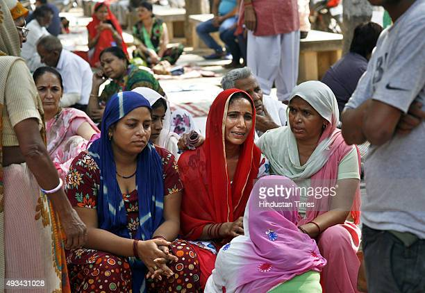 Family members of the two children of a Dalit family who were burnt alive while their parents got injured at Burns Department Safdarjung Hospital on...