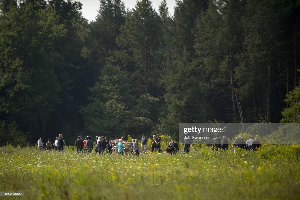 Family members of the victims gather together around the plane crash site at the Flight 93 National Memorial during ceremonies commemorating the 12th anniversary of the 9/11 attacks on September 11, 2013 in Shanksville, Pennsylvania. The nation is commemorating the anniversary of the 2001 attacks, which resulted in the deaths of nearly 3,000 people after two hijacked planes crashed into the World Trade Center, one into the Pentagon in Arlington, Virginia and one crash landed in Shanksville, Pennsylvania.