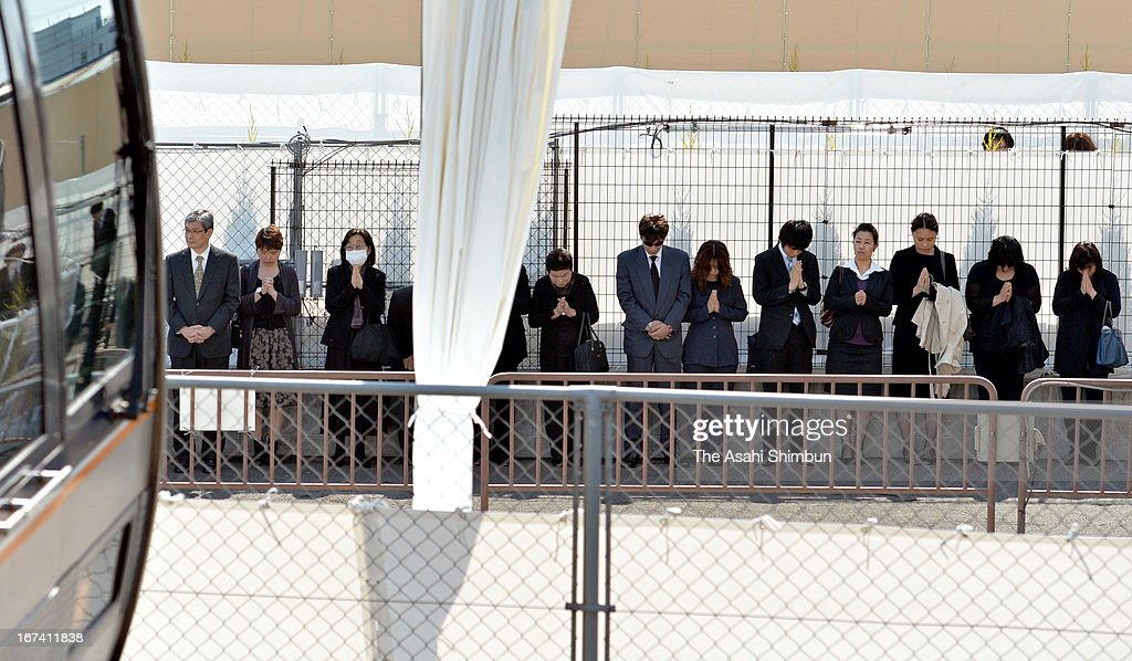 Family members of the victims observe a minute of silence on April 25, 2013 in Amagasaki, Hyogo, Japan. 107 passengers and driver were killed by train derailment in 2005.