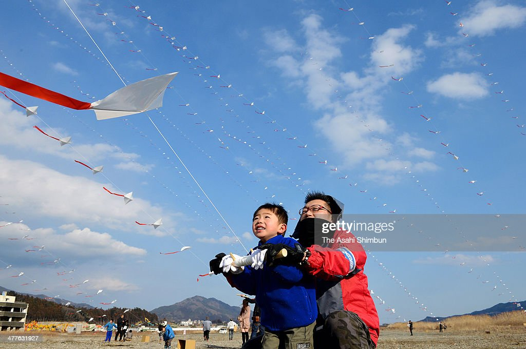 Family members of the victims of the Great East Japan Earthquake and subsequent tsunami from Rikuzentakata anad Ofunato fly the 1,896 trains of kites, equivalent to the number of the victims, on March 9, 2014 in Rikuzentakata, Iwate, Japan. On March 11 Japan commemorates the third anniversary of the magnitude 9.0 earthquake and tsunami.