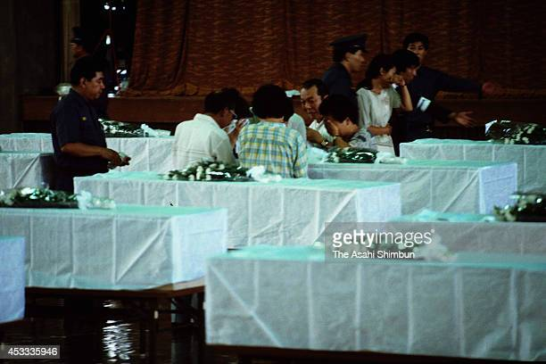 Family members of the victims shed tears at a gymnasium where the recovered bodies are carried on August 14 1985 in Fujioka Gunma Japan Japan...