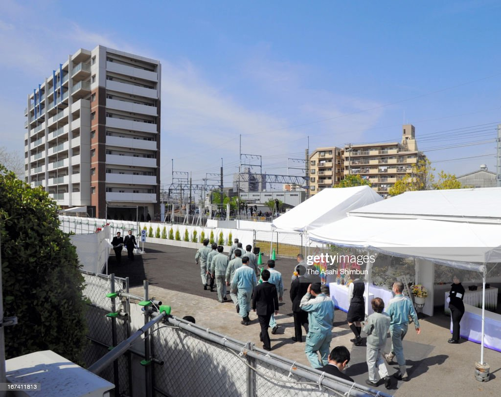 Family members of the victims visit the accident site on April 25, 2013 in Amagasaki, Hyogo, Japan. 107 passengers and driver were killed by train derailment in 2005.