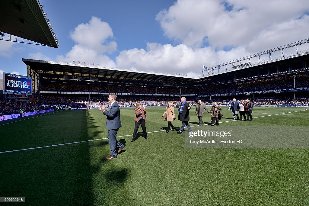Family members of those who were at Hillsborough join both teams on the pitch before the Barclays Premier League match between Everton and A.F.C. Bournemouth at Goodison Park on April 30, 2016 in Liverpool, England.