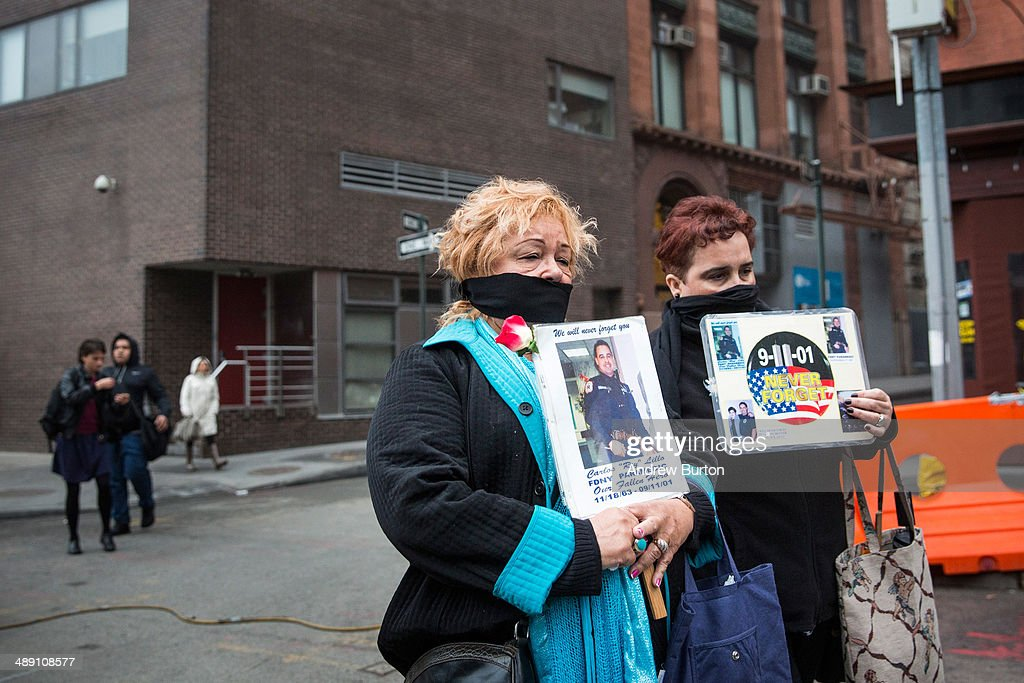 Family members of victims of the September 11, 2001 attacks tie gags around their mouths to protest the decision by city officials to keep unidentified human remains of the 9-11 victims at the 9-11 Museum at the World Trade Center site, on May 10, 2014 in New York City. The decision by city officials to keep the remains at the museum until they are able to be identified has drawn both support and criticism by families of victims. The remains were moved early this morning from the medical examiner's repository to the 9-11 Museum.