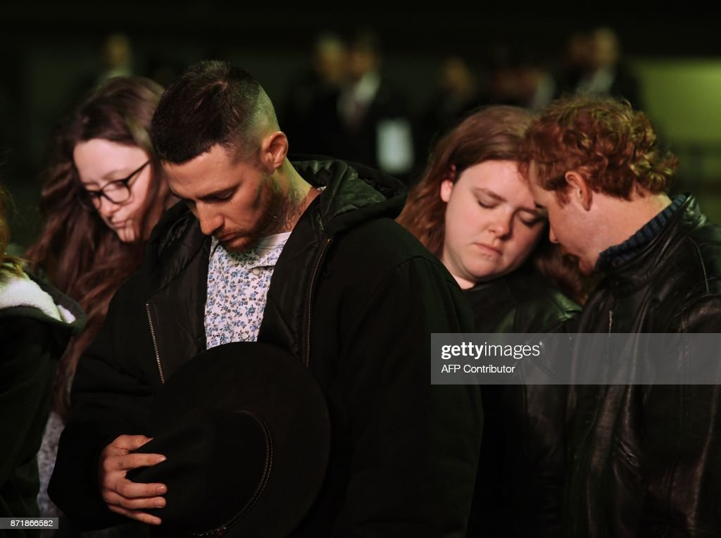 TOPSHOT - Family members of victims pray during a Prayer Vigil Honoring Victims of the First Baptist Church Shooting at the Floresville High School in Floresville, Texas on November 8, 2017. A gunman wearing all black armed with an assault rifle opened fire on a small-town Texas church during Sunday morning services, on November 5, killing 26 people and wounding 20 more in the last mass shooting to shock the United States. /