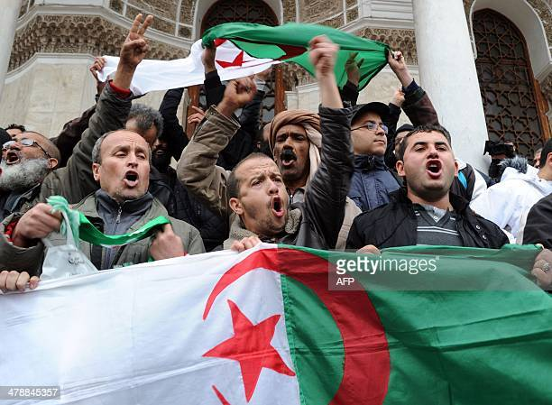 Family members of victims who disappeared during the war in Algeria in the 1990's wave their national flag and shout slogans as they take part in a...