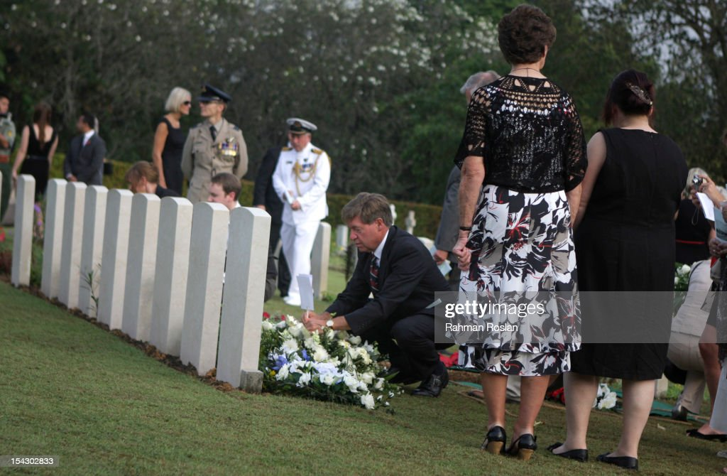 Family members pay their last respect during the burial of eight RAF crew members at the Commonwealth War Cemetery on October 18, 2012 in Kuala Lumpur, Malaysia. The eight crew members were flying a B-24 Liberator on August 23, 1945, eight days after Japan surrendered in World War II, when the plane crashed and was lost near Kuala Pilah, Malaysia. The crash site was undiscovered until the 1990s and human remains were found in 2009 after a detailed investigation.